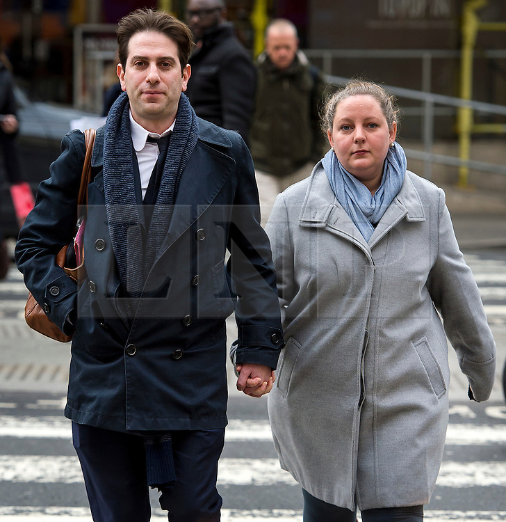 """© Licensed to London News Pictures. 29/01/2016. London, UK. Heterosexual couple CHARLES KEIDAN and REBECCA STEINFELD arrive at the Royal Courts of Justice in London, where a judge is due to rule if they can enter into a civil partnership rather than marriage. The couple, who are both academics and live in London, argue that the Government's position on civil partnerships is """"incompatible with equality law"""".  Photo credit: Ben Cawthra/LNP"""