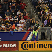 Clint Dempsey, Seattle Sounders, celebrates after scoring past Luis Robles, New York Red Bulls, during the New York Red Bulls Vs Seattle Sounders, Major League Soccer regular season match at Red Bull Arena, Harrison, New Jersey. USA. 20th September 2014. Photo Tim Clayton