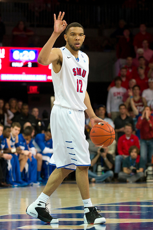 DALLAS, TX - FEBRUARY 01: Nick Russell #12 of the SMU Mustangs brings the ball up court against the Memphis Tigers on February 1, 2014 at Moody Coliseum in Dallas, Texas.  (Photo by Cooper Neill/Getty Images) *** Local Caption *** Nick Russell