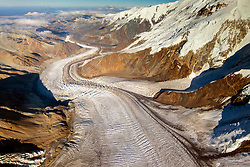 """""""Glacier"""" is an aerial view looking down the icefield of Mount Denali, Alaska. It's a ribbon of ice. To offer some scale to the magnitude of this view, look for the kettle lake in the far left, lower corner of the image."""