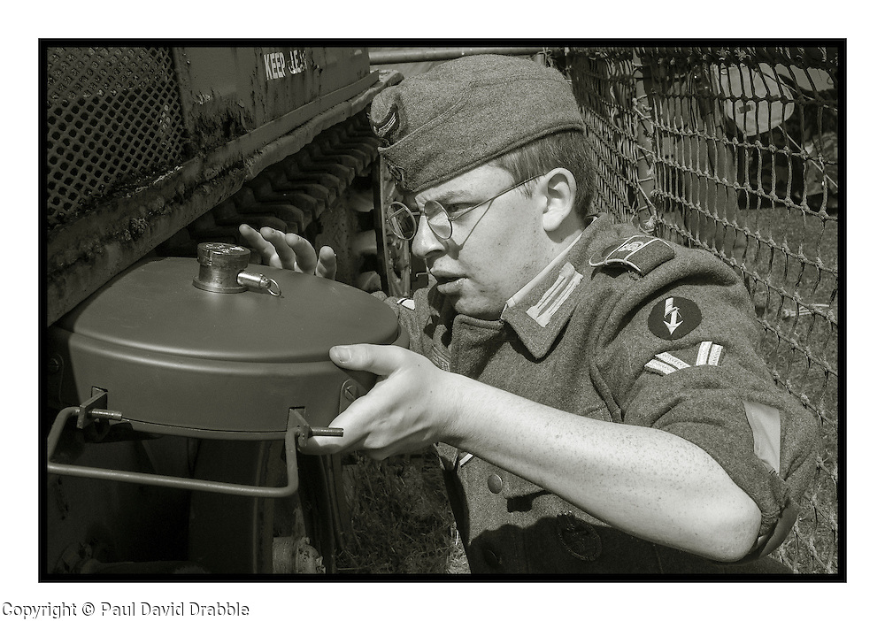 Reenactor portraying a member of 1 Kompanie Gro§deutschland places a teller mine on one of the display tanks at Fort Paull<br /> <br />   04May 2015<br />   Image © Paul David Drabble <br />   www.pauldaviddrabble.co.uk