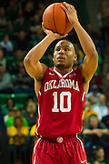 WACO, TX - JANUARY 24: Jordan Woodard #10 of the Oklahoma Sooners shoots a free-throw against the Baylor Bears on January 24, 2015 at the Ferrell Center in Waco, Texas.  (Photo by Cooper Neill/Getty Images) *** Local Caption *** Jordan Woodard