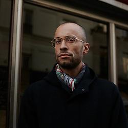 Thomas Chatterton Williams, writer & journalist, posing in the street. Paris, France. December 17, 2019.