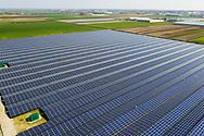 Nederland, Andijk, 20190405<br /> Zonnepark Andijk, een veld met zonnepanelen ter grote van 23 voetbalvelden, levert 15 megawatt stroom op voor 4622 huishoudens<br /> <br /> Foto: (c)Michiel Wijnbergh