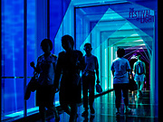 17 DECEMBER 2018 - BANGKOK, THAILAND: Shoppers use an airconditioned walkway to go from Siam Discovery Mall to Siam Center Mall, both upscale malls in central Bangkok. According to Credit Suisse Global Wealth Databook 2018, which surveyed 40 countries, Thailand has the highest rate of income inequality in the world. In 2016, Thailand was third, behind Russia and India. In 2016, the 1% richest Thais (about 500,000 people) owned 58.0% of the Thailand's wealth. In 2018, they controlled 66.9%. In Russia, those numbers went from 78% in 2016, down to 57.1% in 2018. The Thai government disagreed with the report and said the report didn't take government anti-poverty programs into account and that Thailand was held to an unfair standard because most of the other countries in the report are developed countries in the Organisation for Economic Co-operation and Development.     PHOTO BY JACK KURTZ
