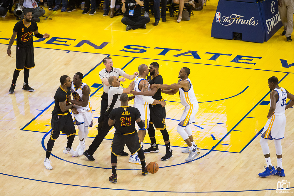 Golden State Warriors forward David West (3) and Cleveland Cavaliers center Tristan Thompson (13) get in an argument during Game 5 of the NBA Finals at Oracle Arena in Oakland, Calif., on June 12, 2017. (Stan Olszewski/Special to S.F. Examiner)