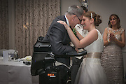 Extraordinary moment paralysed man WALKED 30 steps and stood to give his father of-the-bride speech at his daughter's wedding - powered by a robotic suit <br /> <br /> For most men, giving a father of the bride speech is one of the proudest moments of their lives.<br /> <br /> But after IT consultant Irving Caplan was paralysed in a cycling accident, he feared he may have to address guests at his daughter's wedding from a wheelchair.<br /> <br /> However, thanks to the latest in robotic technology, the 55-year-old walked across the dance floor of a wedding venue last month and delivered his speech standing up.<br /> <br /> Mr Caplan, from Stanmore, Middlesex, broke three vertebrae when he collided with a lorry in Edgware, north-west London on his morning cycle to work two years ago.<br /> <br /> After undergoing a series of operations and spending 12 days in intensive care, he was left tetraplegic and needing a wheelchair to get around.<br /> <br /> When his daughter Joanne announced she was to marry fiancé Mike Beaumont, Mr Caplan feared he would be unable to walk his daughter down the aisle or deliver his speech standing up.<br /> <br /> But after he and wife Karen, 57, met a representative of Rex Bionics at an exhibition of technologies for the disabled, he was lent the robotic suit to allow him to stand and walk.<br /> <br /> 'The guests were gobsmacked when I walked out. It was the usual speech, thanking everyone for coming and hoping everybody had a good evening, but I certainly surprised them all with my entrance.<br /> <br /> 'It wasn't possible for a number of reasons for me to walk Joanne down the aisle, but I was able to do my speech standing up.<br /> <br /> 'It is quite an issue when you end up in a wheelchair, being at the wrong height compared to everybody else. But being able to speak to everybody from the right height did make quite a difference.<br /> <br /> 'It made a difference to me in the sense that I was doing it from the right perspective.<br