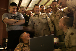 Soldiers from the 724th Transportation Company, watch a slide show of their trip to Iraq, with some funny moments as well as more somber ones, Kuwait, Feb, 2, 2005. They are  resting up to go back to the United States after deployment. A member of their unit, Army Spc. Keith Matt Maupin, was taken hostage. He is the only US soldier that is listed MIA from this war.