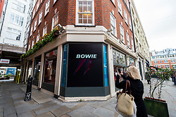 © Licensed to London News Pictures. 25/10/2021. LONDON, UK.  Exterior of a David Bowie pop-up shop in Heddon Street in the West End.  Open 75 days before the late singer's 75th birthday, the pop-up is located close to where Bowie posed as Ziggy Stardust on the cover of his 1972 album The Rise and Fall of Ziggy Stardust and the Spider from Mars.  The store sells limited edition records and memorabilia curated by his estate and will be open until January 2022. A sister shop will open in New York and both form part of a year long celebration of David Bowie's 75th birthday.  Photo credit: Stephen Chung/LNP