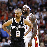 17 January 2012: San Antonio Spurs point guard Tony Parker (9) and Miami Heat small forward LeBron James (6) laugh during the Miami Heat 120-98 victory over the San Antonio Spurs at the AmericanAirlines Arena, Miami, Florida, USA.