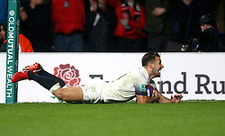 England's Danny Care scores his side's fourth try during the Autumn International at Twickenham Stadium, London.