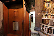 close up of a confessional with cross
