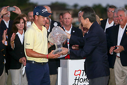 February 25, 2018 - Palm Beach Gardens, Florida, U.S. - Justin Thomas receives the Honda Classic trophy from Honda president and CEO of Honda North America, Toshiaki Mikoshiba, after winning the 2018 Honda Classic on the first playoff hole at PGA National Resort and Spa in Palm Beach Gardens, Fla., on Sunday, February 25, 2018. (Credit Image: © Andres Leiva/The Palm Beach Post via ZUMA Wire)