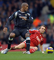 Photo: Paul Greenwood.<br />Liverpool v Manchester City. The Barclays Premiership. 25/11/2006. Liverpool's Bolo Zenden, rear, gets the ball off Manchester City's Sylvain Distin