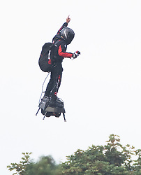 © Licensed to London News Pictures. 04/08/2019. Dover, UK. French inventor Franky Zapata gestures as he comes in to land at St Margarets Bat near Dover after crossing the English Channel on his jet-powered hoverboard. He is hoping to make the 35km crossing with a refueling stop mid channel to reach the English coast after setting off at 6am French time. Photo credit: Peter Macdiarmid/LNP