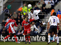 Photo: Jed Wee.<br /> Preston North End v Middlesbrough. The FA Cup. 19/02/2006.<br /> <br /> Preston's Claude Davis (R) jumps over Middlesbrough's Yakubu to win the ball.