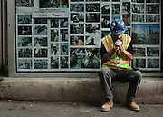 Worker during a break. New York, 18 june 2010. Christian Mantuano / OneShot