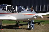 Wurtsboro, New York - A pilot cleans the windshield his Valentin 17E Taifun motorglider at Wurtsboro Airport on Oct. 9, 2010.