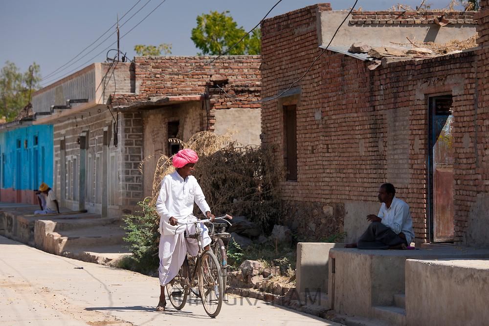Indian men chatting at Jawali village in Rajasthan, Northern India