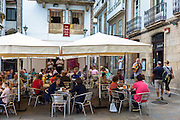 Spanish guitarist serenading diners at Casa Camilo bar restaurant in Santiago de Compostela, Galicia, Spain