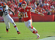 KANSAS CITY, MO - OCTOBER 27:  Quarterback Alex Smith #11 of the Kansas City Chiefs rushes up the sideline for a first down past linebacker Barkevious Mingo #51 of the Cleveland Browns during the first half on October 27, 2013 at Arrowhead Stadium in Kansas City, Missouri.  (Photo by Peter Aiken/Getty Images) *** Local Caption *** Alex Smith;Barkevious Mingo