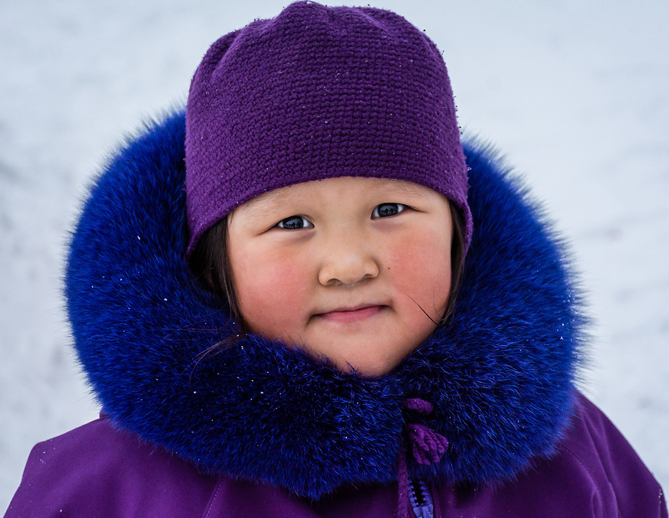 A pretty little Inuit girl looking at me. She was very patient.