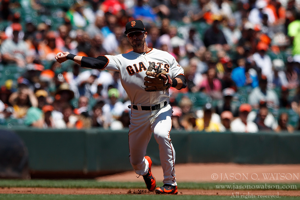 SAN FRANCISCO, CA - JULY 15: Chase d'Arnaud #2 of the San Francisco Giants throws to first base against the Oakland Athletics during the first inning at AT&T Park on July 15, 2018 in San Francisco, California. The Oakland Athletics defeated the San Francisco Giants 6-2. (Photo by Jason O. Watson/Getty Images) *** Local Caption *** Chase d'Arnaud