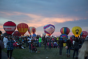 Balloons inflate on the field at the AARP Block Party at the Albuquerque International Balloon Fiesta in Albuquerque New Mexico USA on Oct. 7th, 2018.