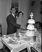24/9/1952<br /> 9/24/1952<br /> 24 September 1952<br /> <br />  Wedding of Miss O'Dwyer at North William St. Church Cutting the cake