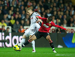 19.11.2011, Liberty Stadion, Swansea, ENG, PL, Swansea City vs Manchester United, 12. Spieltag, im Bild Swansea City's Garry Monk in action against Manchester United's Javier Hernandez during the Premiership match at the Liberty Stadium. (Pic by David Rawcliffe/Propaganda). EXPA Pictures © 2011, PhotoCredit: EXPA/ Sportida/ David Rawcliff..***** ATTENTION - OUT OF ENG, GBR, UK *****