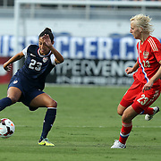 U.S. forward Christen Press (23) dribbles the ball past Russia player Elena Morozova (23) during an international friendly soccer match between the United States Women's National soccer team and the Russia National soccer team at FAU Stadium on Saturday, February 8, in Boca Raton, Florida. The U.S. won the match by a score of 7-0. (AP Photo/Alex Menendez)