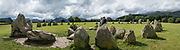 The mysterious Castlerigg Stone Circle dates from circa 3000 BC, in Lake District National Park, Keswick, England, United Kingdom, Europe. This Neolithic circle is about 97.5 ft (30 m) in diameter, with 38 stones remaining of formerly 42, varying in height from 3.3 to 7.5 ft. England Coast to Coast hike day 4 of 14. [This image, commissioned by Wilderness Travel, is not available to any other agency providing group travel in the UK, but may otherwise be licensable from Tom Dempsey – please inquire at PhotoSeek.com.] This image was stitched from multiple overlapping photos.
