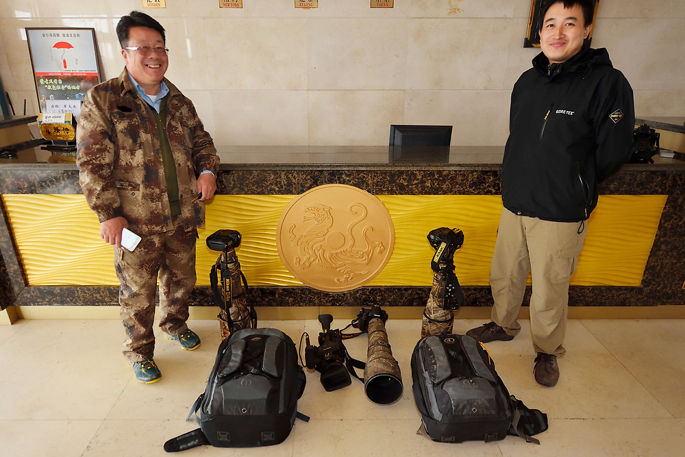 Nikon equipment and photographers Li Yuliang, left and Wu Ying, right, Inner Mongolia, China