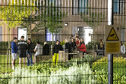 © Licensed to London News Pictures. 26/09/2020. Manchester, UK. Students at Manchester Metropolitan University ( MMU ) (pictured in a courtyard within the campus) have been told to isolate within their Halls of Residence for fourteen days after several Coronavirus outbreaks have been identified across the campus . Several report being denied permission to move to and from the University campus , enforced by security guards , saying they have been told that, if they step outside , they will not be able to return for at least 14 days . Photo credit: Joel Goodman/LNP