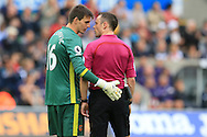 referee Stuart Attwell has words with Eldin Jakupovic , the Hull city goalkeeper.Premier league match, Swansea city v Hull city at the Liberty Stadium in Swansea, South Wales on Saturday 20th August 2016.<br /> pic by Andrew Orchard, Andrew Orchard sports photography.