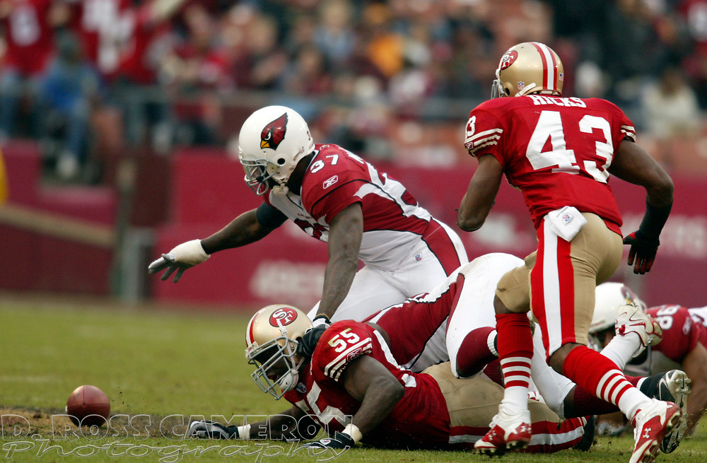 Arizona Cardinals' Hanik Milligan (37) vies for a loose ball with San Francisco 49ers' Hannibal Navies (55) and Maurice Hicks after Cardinals punt returner Troy Walter fumbled in the third quarter of their NFL football game, Sunday, Dec. 24, 2006 at Candlestick Park in San Francisco.  The 49ers recovered the ball.  The Cardinals won, 26-20. (D. Ross Cameron/The Oakland Tribune)