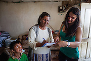 Romina Kajtazova - working as a paralegal for NGO Kham - talking during field work to Ljutvia Demyrova - a 29 years old mother of 8 children at her home located at the local Roma community during the European Immunization Week in the city of Vinica in Macedonia.
