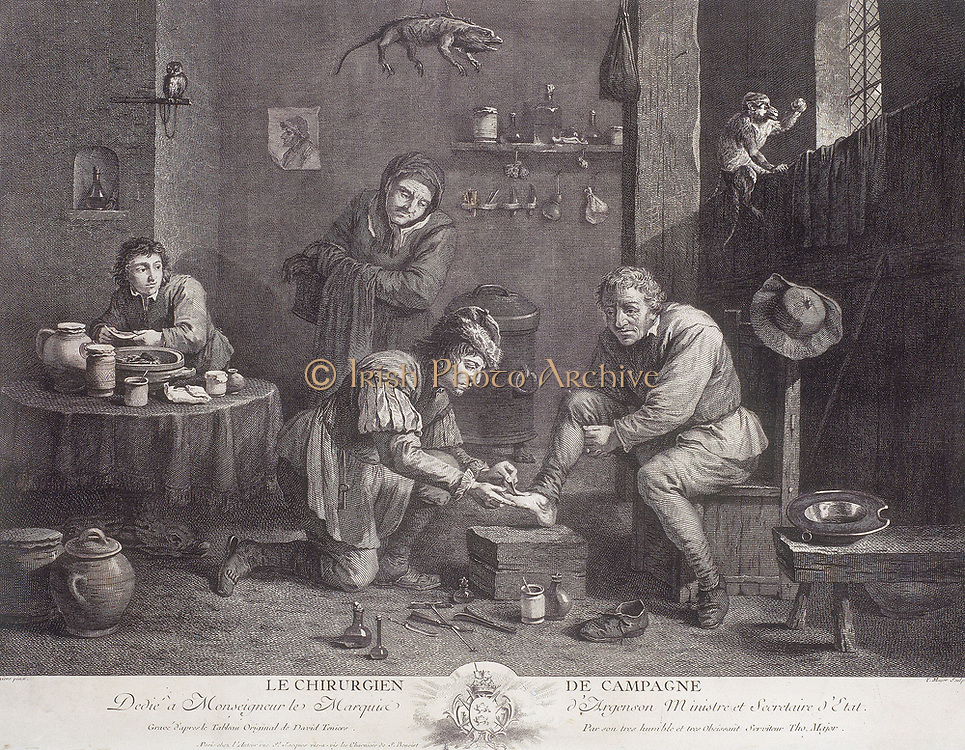 Le Chirugien de Campagne' ('The Country Surgeon'). Engraving c1747 by Thomas Major after David Teniers, showing the interior of a barber-surgeon's premises. The walls are decorated with animals, potions and medical instruments, and a seated man is shown having his foot attended to. Various items of  equipment are spread out on the floor.