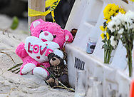 Flowers and mementos are left on the beach near the partially collapsed 12-story oceanfront condominium, Champlain Towers South, in Surfside, Florida on Friday, July 2, 2021.