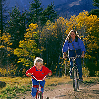 A mother & son cycle under Mt. Humphreys in the eastern Sierra Nevada.