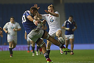 France Martin Devergie kicks during the Under 20s Six Nations Championship match between England and France at the American Express Community Stadium, Brighton and Hove, England on 20 March 2015. Photo by Phil Duncan.