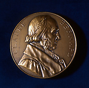 Claude Bernard, French physiologist. From the obverse of a commemorative medal. Bernard (1813-1878) investigated the liver, discovering glycogen, and determined that most of the process of digestion occurs in the small intestine, rather that the stomach. He showed that haemoglobin carries oxygen in red blood cells, and demonstated how carbon monoxide poisoning disrupted this process. When Bernard died in 1878, the French government organised his funeral, making him the first French scientist to be honoured in this way.