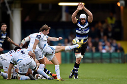 Will Chudley of Exeter Chiefs box-kicks the ball as Dave Attwood of Bath Rugby looks to charge him down - Mandatory byline: Patrick Khachfe/JMP - 07966 386802 - 10/10/2015 - RUGBY UNION - The Recreation Ground - Bath, England - Bath Rugby v Exeter Chiefs - West Country Challenge Cup.