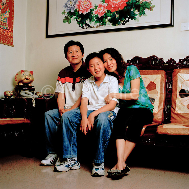 Zeng Shao Lin, 43, a housewife and her husband, Yang Wei Jun, 42 a driver for a Hong Kong company have a son, Yang Heng who is 12 and at junior school. They live in Shenzhen. Shao Lin suffers from depression and feels this is because she and her husband were unable to afford the fine (around £32,000 - the equivalent of several years salary) they would have had to pay to have another child. ..Its over thirty years (1978) since the Mao's Chinese government brought in the One Child Policy in a bid to control the world's biggest, growing population. It has been successful, in controlling growth, but has led to other problems. E.G. a gender in-balance with a projected 30 million to many boys babies; Labour shortages and a lack of care for the elderly.