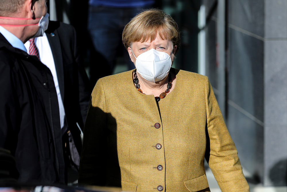 German Chancellor Angela Merkel leaves the Federal Press Conference House following a press conference regarding the tightening of the lockdown, Berlin, Germany, January 21, 2021. In an 11 hour discussion the on January 19 Merkel and the heads of the 16 German federal states decided on the widening of the health restrictions meant to deal with the spread of the coronavirus, the lockdown will remain at hand until mid February.