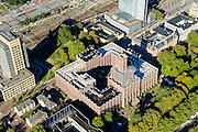 Nederland, Utrecht, Gemeente Utrecht, 30-09-2015;  Moreelsepark met in de voorgrond de Inktpot, oud hoofdkantoor Nederlandse Spoorwegen, hoofdadministratiegebouw III (hgb III). Nu kantoor ProRail. In de achtergrond  Centraal Station en Hoog Catherijne.<br /> Moreelsepark, old headquarters Dutch Railways, now office ProRail. Central Station and Hoog Catherijne <br /> <br /> luchtfoto (toeslag op standard tarieven);<br /> aerial photo (additional fee required);<br /> copyright foto/photo Siebe Swart