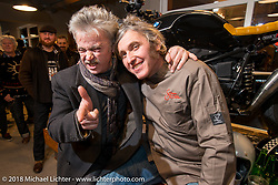 Nicola Martini with a friend at his Mr. Martini Friday night party celebrating the opening of his bar / restaurant at the workshop during the Motor Bike Expo. Verona, Italy. January 22, 2016.  Photography ©2016 Michael Lichter.