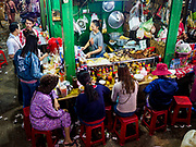 """14 FEBRUARY 2019 - SIHANOUKVILLE, CAMBODIA:  A food stall in the Leu Market in Sihanoukville. There are about 80 Chinese casinos and resort hotels open in Sihanoukville and dozens more under construction. The casinos are changing the city, once a sleepy port on Southeast Asia's """"backpacker trail"""" into a booming city. The change is coming with a cost though. Many Cambodian residents of Sihanoukville  have lost their homes to make way for the casinos and the jobs are going to Chinese workers, brought in to build casinos and work in the casinos.      PHOTO BY JACK KURTZ"""