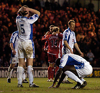Photo: Jed Wee.<br /> Middlesbrough v Nuneaton Borough. The FA Cup. 17/01/2006.<br /> <br /> Nuneaton players suffer disappointment as Gaizka Mendieta earns Middlesbrough a penalty.