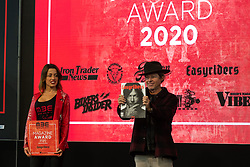 Easyriders Magazine owner Pepper Foster gave his award to Hardnine Choppers' customizer Danny Schneider of Bern, Switzerland for the Magazine Awards at Motor Bike Expo (MBE) bike show. Verona, Italy. Sunday, January 19, 2020. Photography ©2020 Michael Lichter.